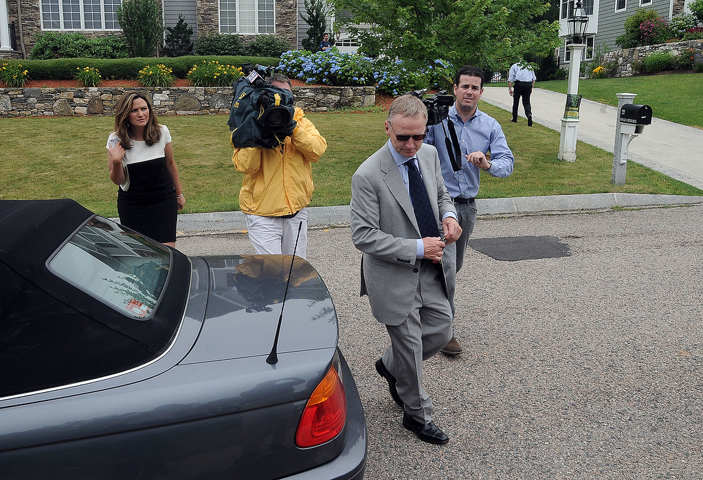 . An unidentified attorney of former New England Patriots football player Aaron Hernandez, right, leaves Hernandez\'s home after securing some dress clothes from the house Thursday, June 27, 2013, in North Attleboro, Mass.  A judge on Thursday denied bail for the former NFL player, who is charged with first-degree murder in the shooting death of a friend. (AP Photo/The Attleboro Sun Chronicle, Mark Stockwell)