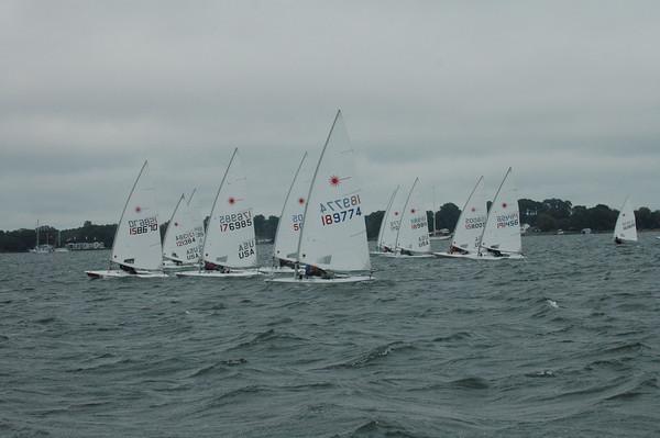 Fleet sailing upwind on race 3.