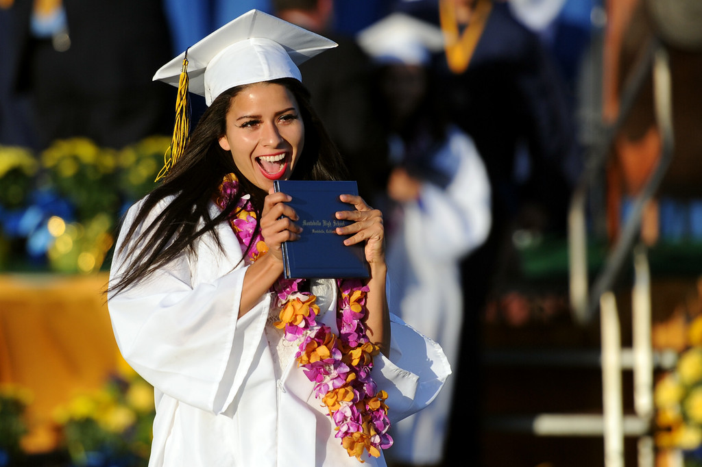 . Christine Bravo reacts after receiving her diploma during the Montebello High School commencement at Montebello High School on Thursday, June 20, 2013 in Montebello, Calif.  (Keith Birmingham/Pasadena Star-News)
