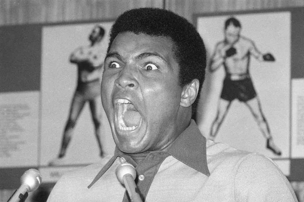 . Boxer Muhammad Ali displays an array of facial calisthenics during a press luncheon in New York, Aug. 29, 1974 to promote the sale of tickets to Madison Square Garden where the battle against George Foreman in Zaire will be shown in October on closed circuit television.  (AP Photo/Ron Frehm)