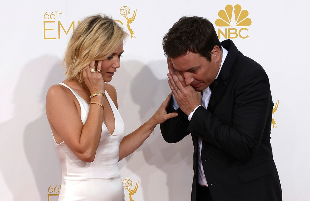 . Kristen Wiig and Jimmy Fallon on the red carpet at the 66th Primetime Emmy Awards show at the Nokia Theatre in Los Angeles, California on Monday August 25, 2014. (Photo by John McCoy / Los Angeles Daily News)
