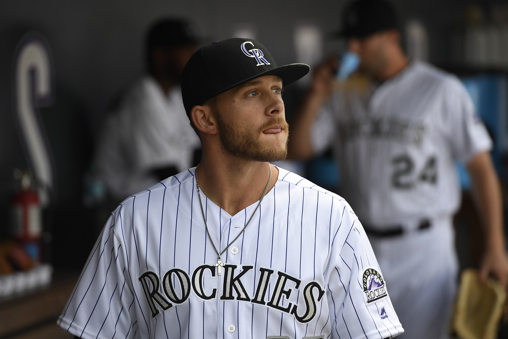 . Trevor Story (27) of the Colorado Rockies looks out to the field before the game. The Colorado Rockies played the San Diego Padres Friday, April 8, 2016 on opening day at Coors Field in Denver, Colorado. (Photo By Andy Cross/The Denver Post)