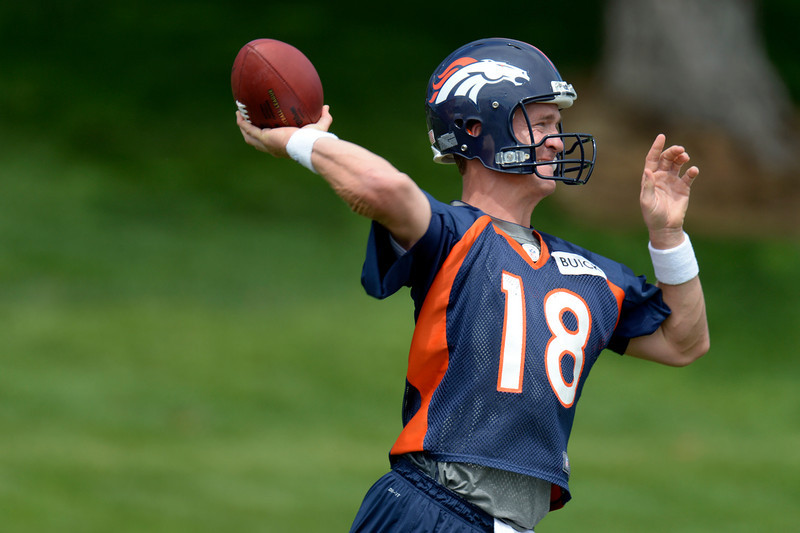 . Peyton Manning (18) of the Denver Broncos throws a pass during drills at mini camp June 12, 2013 at Dove Valley. (Photo By John Leyba/The Denver Post)