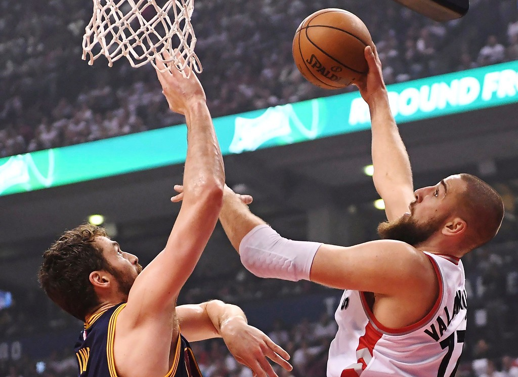 . Toronto Raptors center Jonas Valanciunas (17) shoots over Cleveland Cavaliers forward Kevin Love, left, during the first half of Game 3 of an NBA basketball second-round playoff series in Toronto on Friday, May 5, 2017. (Frank Gunn/The Canadian Press via AP)
