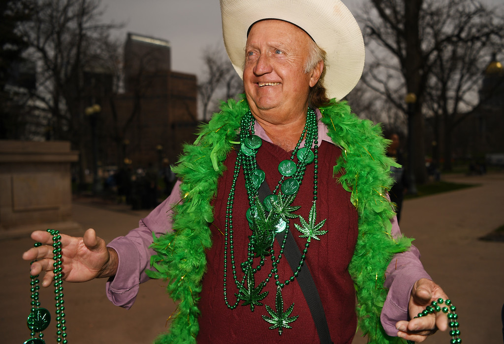 . Jerry Ludke sells weed necklaces during the 420 celebration at Civic Center Park in Denver, April 20, 2016. People gather at the park to celebrate marijuana. (Photo by RJ Sangosti/The Denver Post)