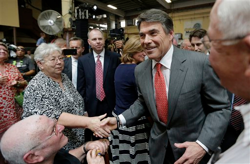 Description of . Texas Gov. Rick Perry greets supporters as he leaves Holt Cat, Monday, July 8, 2013, in San Antonio after announcing he will not seek reelection.  A staunch Christian conservative, proven job-creator and fierce defender of states' rights, Perry has been in office nearly 13 years, making him the nation's longest-sitting current governor. (AP Photo/Eric Gay)