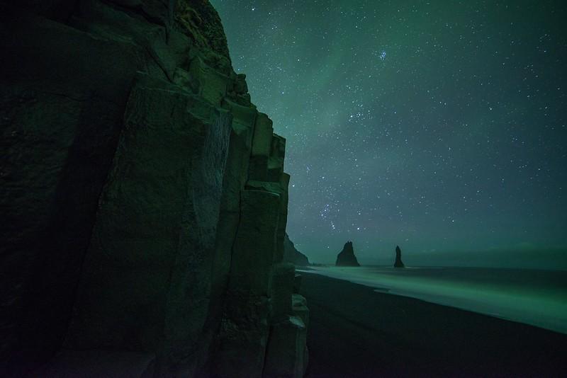 northern lights in iceland - black sand beach vik