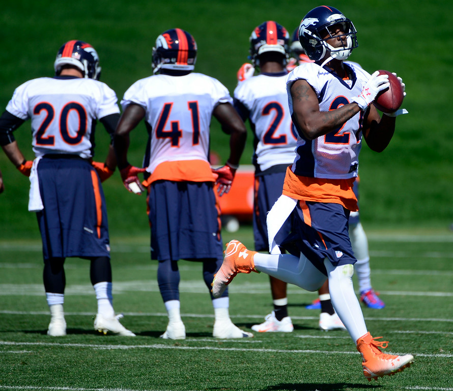 . CENTENNIAL, CO - AUGUST 19: Aqib Talib (21) runs through drills during practice on Tuesday, Aug. 19, 2014. The Denver Broncos prepare at Dove Valley on Tuesday, Aug. 19, 2014 in Centennial for their upcoming game against the Houston Texans on Saturday, Aug. 23, 2014. (Photo by Kathryn Scott Osler/The Denver Post)