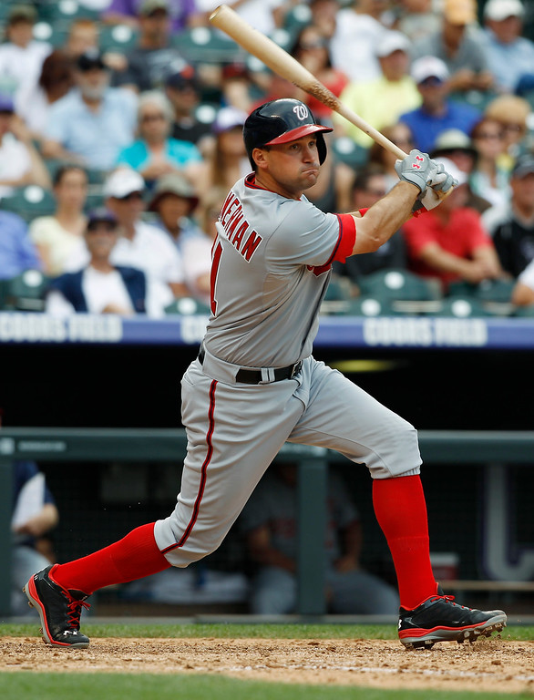 . Washington Nationals\' Ryan Zimmerman hits an RBI-double in the eighth inning of a baseball game against the Colorado Rockies Thursday, June 13, 2013, in Denver. The Nationals won 5-4.  (AP Photo/David Zalubowski)