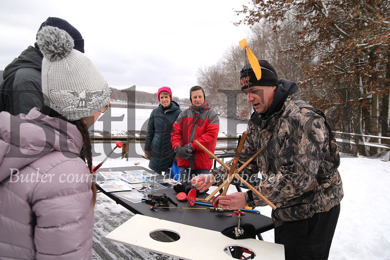 Toddy Young of Muddy Creek Fishing Guides demonstrates ice fishing techniques and gear at Moraine State Park's Winterfest Saturday. Seb Foltz/Butler Eagle 02/09/20