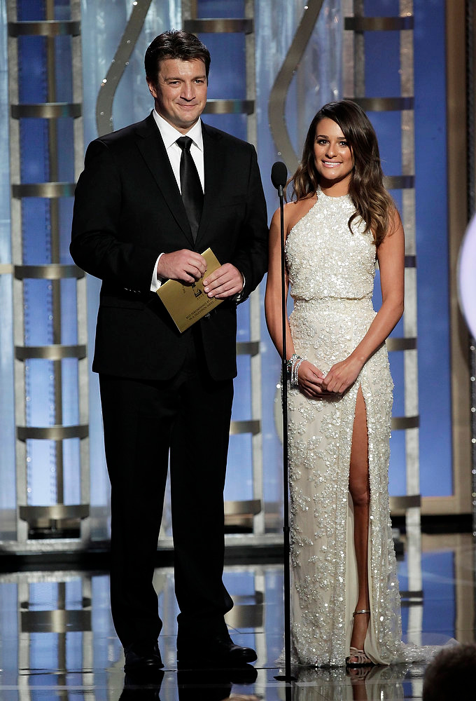. This image released by NBC shows presenters Nathan Fillion, left, and Lea Michele during the 70th Annual Golden Globe Awards at the Beverly Hilton Hotel on Jan. 13, 2013, in Beverly Hills, Calif. (AP Photo/NBC, Paul Drinkwater)