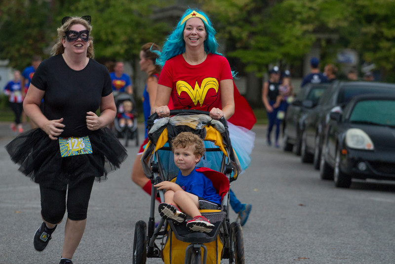 Runners took on superhero identities on a rainy Saturday morning as they ran through downtown Bentonville during the Superhero Scramble 5k.