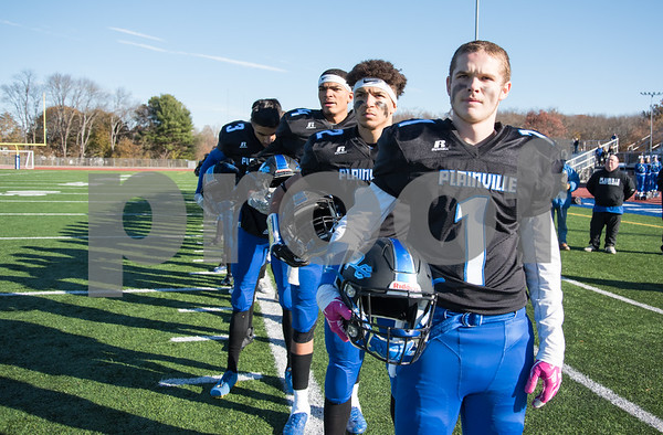11/23/17 Wesley Bunnell | Staff Plainville football was defeated by Farmington on Thanksgiving morning for The Olde Canal Cup. Cody Marquis (1) and teammates line up for the National Anthem.