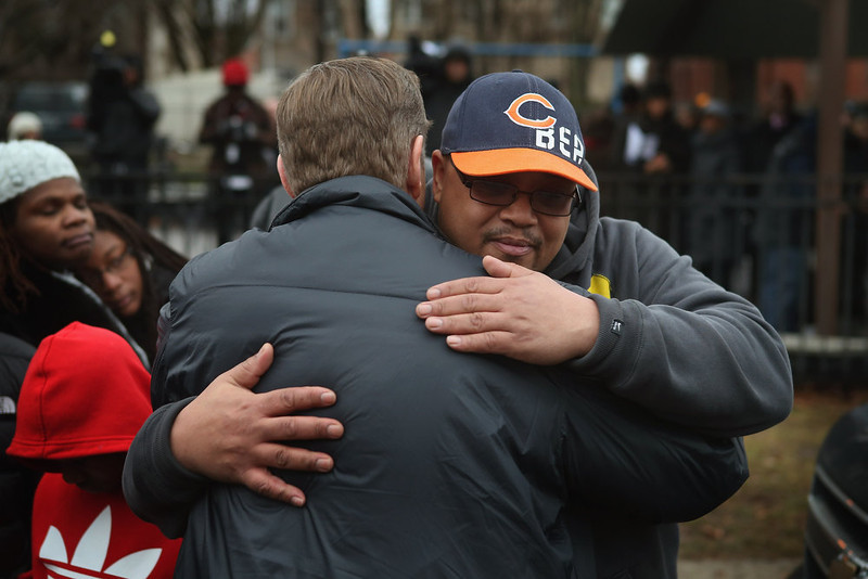 . Nate Pendleton (R) is comforted near the neighborhood park where his daughter Hadiya was killed on January 30, 2013 in Chicago, Illinois. Fifteen-year-old Hadiya was shot and killed when a gunman opened fire in the park yesterday while she was hanging out with friends on the warm rainy afternoon under a shelter in the park. Hadiya was a majorette in her high school band and recently performed in Washington, D.C. during the inauguration. President Obama\'s Chicago home is less than a mile from the park where Hadiya was killed.   Another person was wounded in the leg during the shooting.   (Photo by Scott Olson/Getty Images)