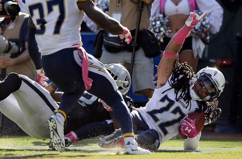 . Jason Verrett #22 of the San Diego Chargers reacts after he intercepted a pass intended for Brice Butler #12 of the Oakland Raiders in the fourth quarter that clinched their victory at O.co Coliseum on October 12, 2014 in Oakland, California.  (Photo by Ezra Shaw/Getty Images)
