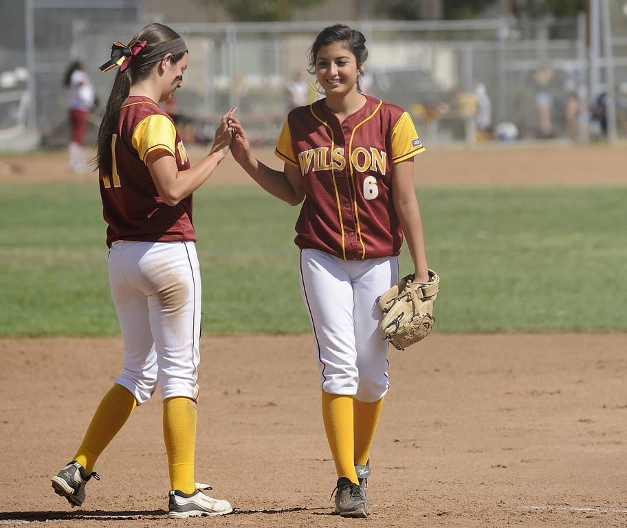 . LONG BEACH, CALIF. USA -- Wilson\'s Kori Cochran (11) and Gabrielle Juarez (6) before their their Moore League game against in Lakewood, Calif., on May 2, 2013. Lakewood defeated Wilson 11-1 in five innings.  Photo by Jeff Gritchen / Los Angeles Newspaper Group