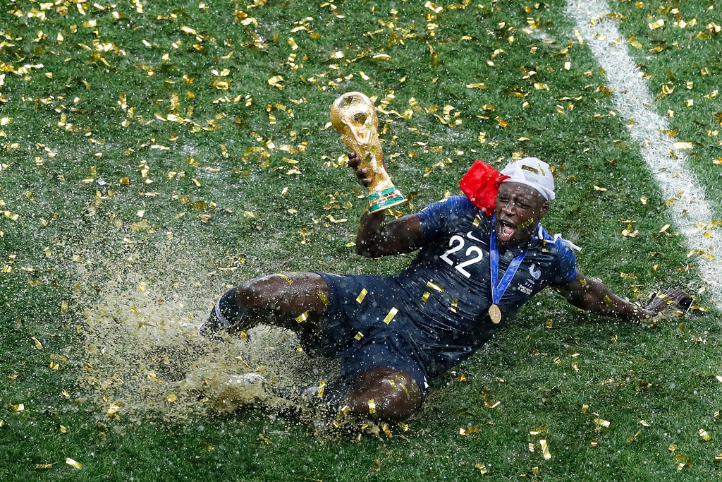 . France\'s Benjamin Mendy celebrates with the trophy after the final match between France and Croatia at the 2018 soccer World Cup in the Luzhniki Stadium in Moscow, Russia, Sunday, July 15, 2018. (AP Photo/Rebecca Blackwell)