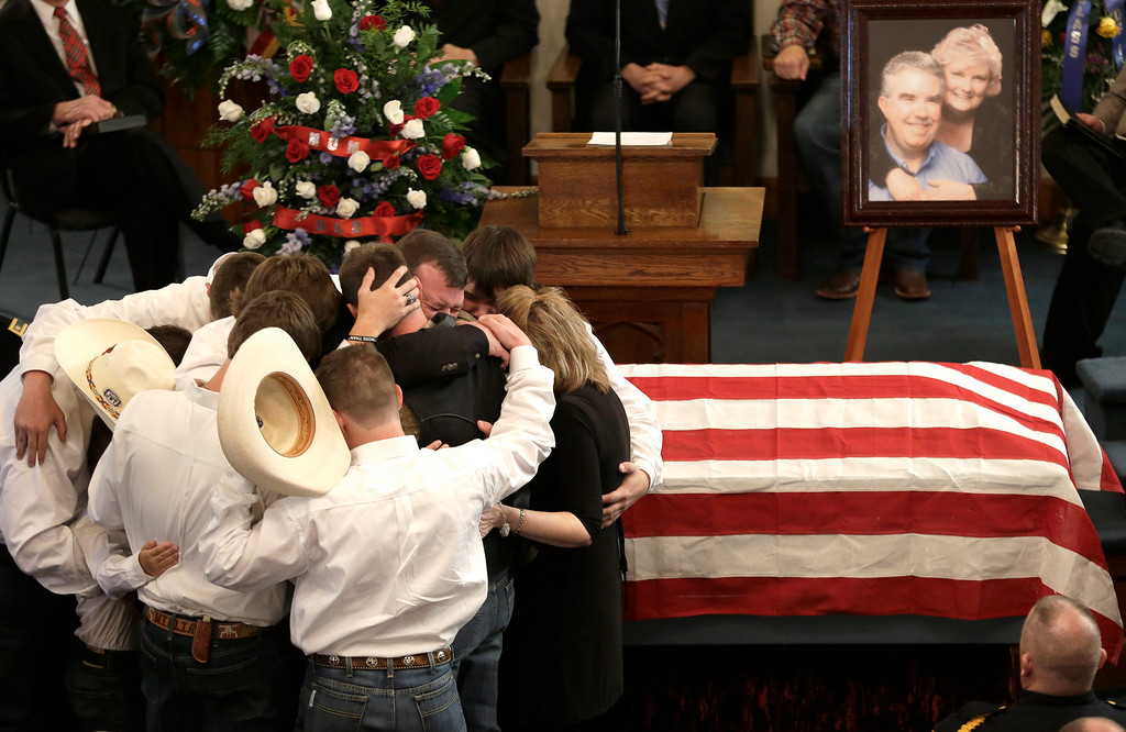 . The family of Kaufman County District Attorney Mike McLelland and his wife, Cynthia, comfort each other during their funeral services at  the First Baptist Church of Wortham Friday, April 5, 2013, in Wortham, Texas.  The couple was found shot to death in their house near Forney, about 20 miles east of Dallas.  (AP Photo/LM Otero)