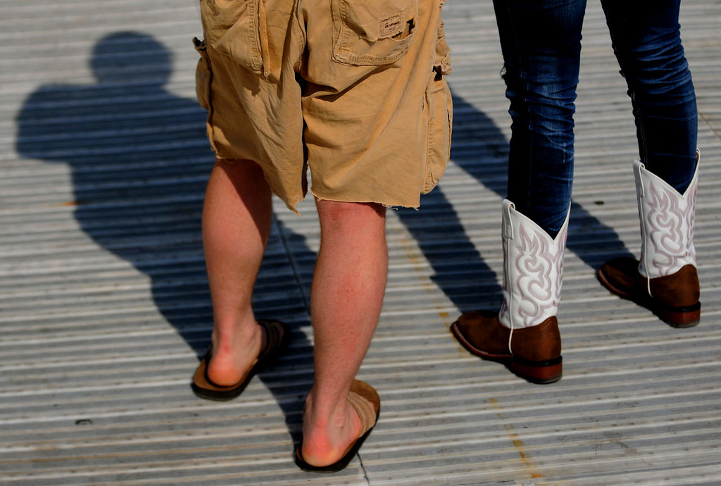 . A couple, he in flip-flops and she sporting cowboys boots, listen to Kacey Musgraves. (Pioneer Press: John Autey)