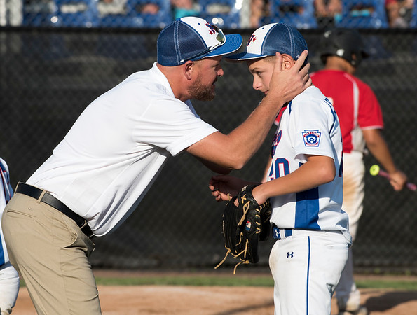 08/05/19 Wesley Bunnell | Staff New York Haverstraw Little League defeated Delewar's Neward National Little League Monday evening at Breen Field in Bristol. Cameron Kelley (20) receives encouragement from Manager Frank Thornton at the end of an inning.