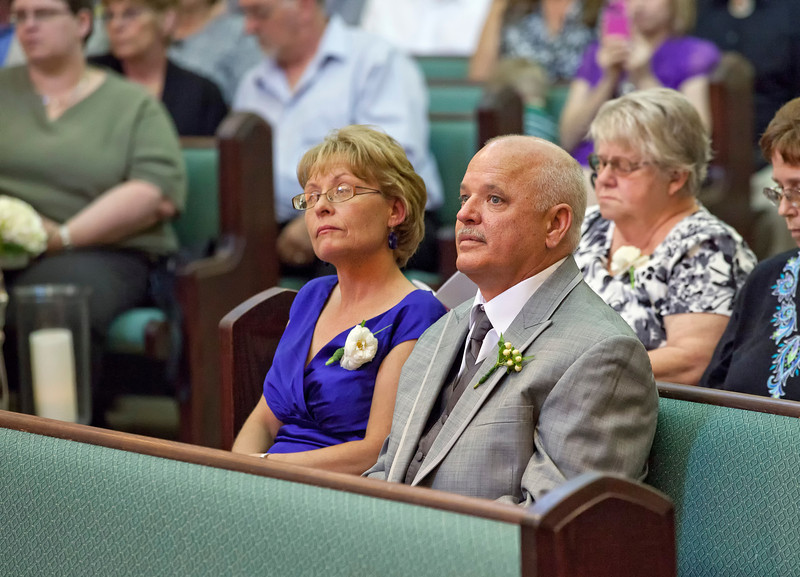 Brides parents in their seats.jpg