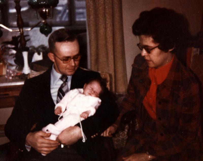 Ellen being held by her Dad