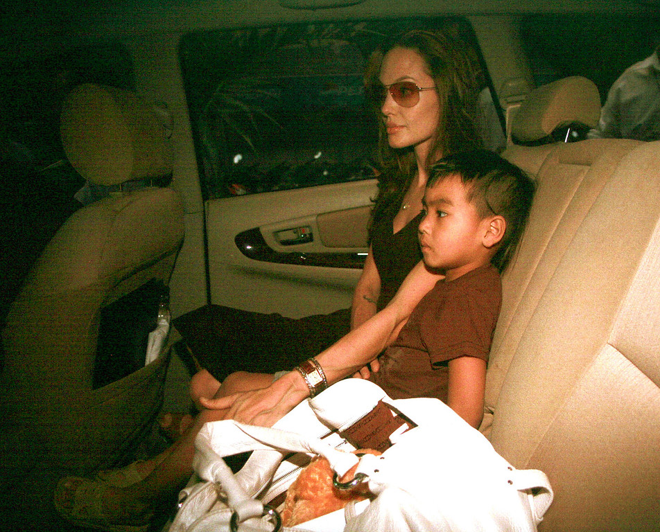 . American Actress Angelina Jolie sits at the back seat with her adopted son Maddox from Cambodia as she leaves Tam Binh orphanage in Ho Chi Minh City Thursday, March 15, 2007. Jolie arrived in this southern Vietnamese city Wednesday night to adopt a 3-year-old boy who has been living at the orphanage since he was abandoned at a hospital as an infant, according to adoption officials. (AP Photo)