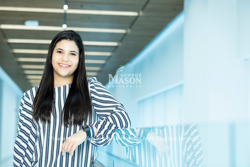Senior Mariana Estrada conducted a survey of how accommodating Mason is to students with children. Photo by Lathan Goumas/Strategic Communications