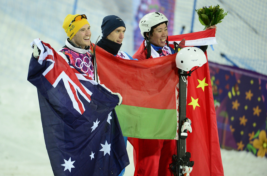 . (L-R) Silver Medallist, Australia\'s David Morris; Gold Medallist, Belarus\' Anton Kushnir; and Bronze Medallist, China\'s Jia Zongyang celebrate at the Men\'s Freestyle Skiing Aerials Flower Ceremony at the Rosa Khutor Extreme Park during the Sochi Winter Olympics on February 17, 2014.    JAVIER SORIANO/AFP/Getty Images