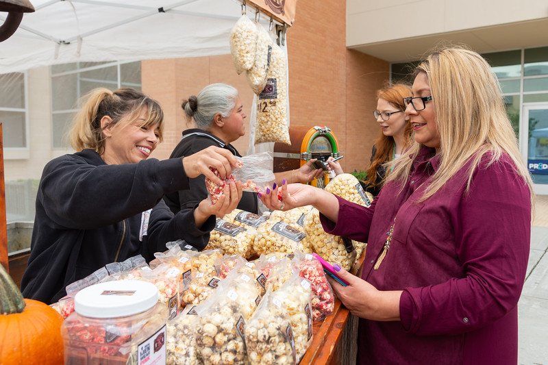 Eliza Lara trying different popcorn flavors at the 2018 Fall Festival.