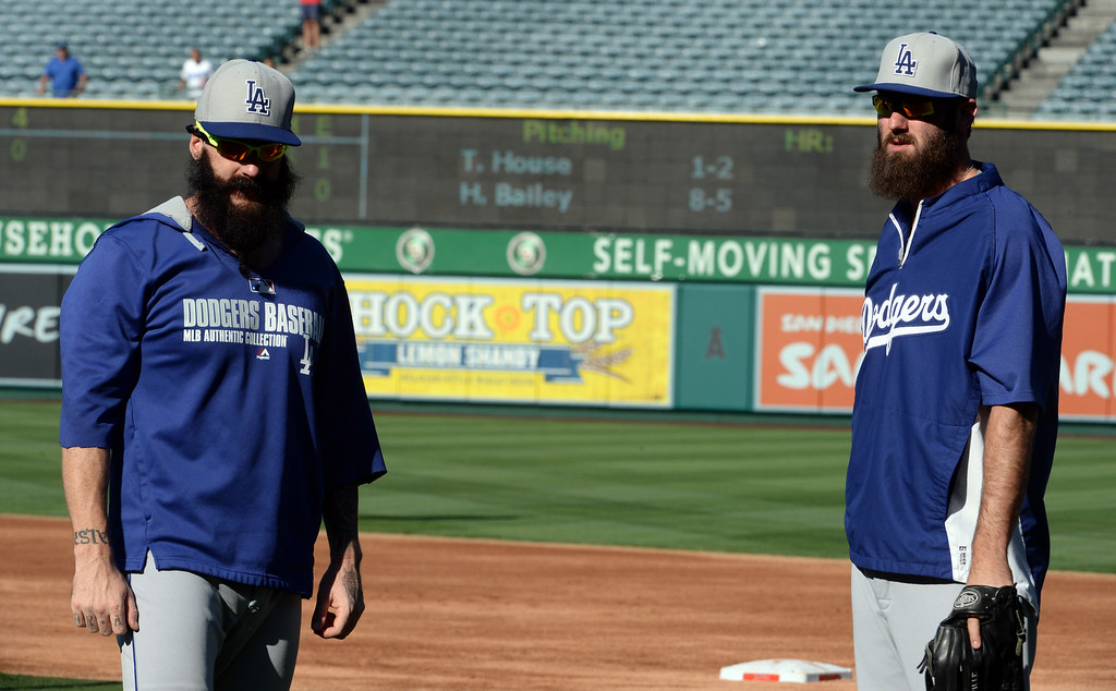 . Los Angeles Dodgers\' Brian Wilson, left, along with Scott Van Slyke prior to a baseball game against the Los Angeles Angels at Anaheim Stadium in Anaheim, Calif., on Thursday, Aug. 7, 2014.  (Photo by Keith Birmingham/ Pasadena Star-News)