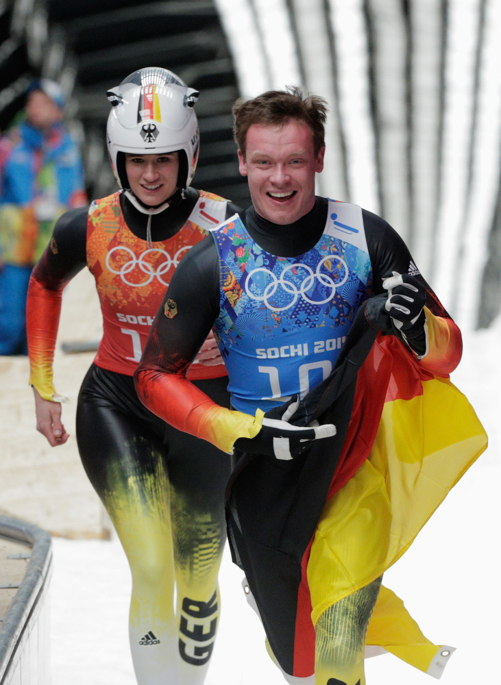 . Natalie Geisenberger (L) and Felix Loch of Germany react after a run during the Luge Relay on Day 6 of the Sochi 2014 Winter Olympics at Sliding Center Sanki on February 13, 2014 in Sochi, Russia.  (Photo by Adam Pretty/Getty Images)