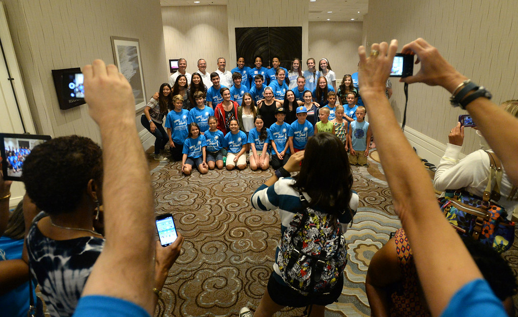. Triplets from around the globe converged at the Crowne Plaza Hotel for the National Triplet Convention Saturday, July 12, 2014, Redondo Beach, CA  The triplets gather together for photos by family and friends. Photo by Steve McCrank/Daily Breeze