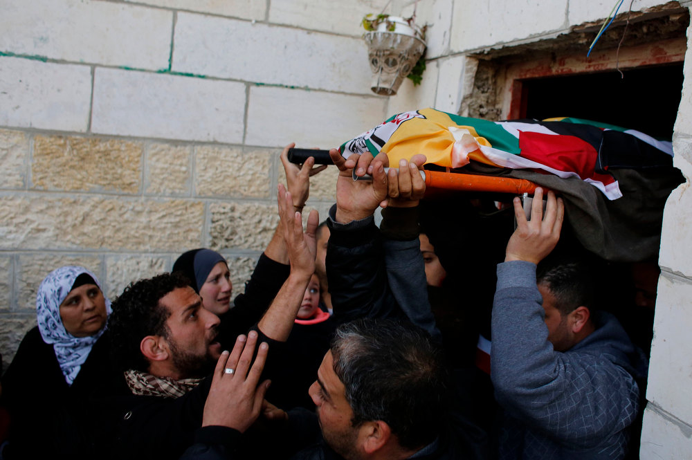 . Palestinians carry the body of Lubna Hanash during her funeral in the West Bank town of Bethlehem January 23, 2013. Israeli soldiers shot and killed Hanash, a 21-year-old Palestinian woman, near Hebron on Wednesday and wounded another local youth, Palestinian medics said. Asked about the incident, an Israeli army spokeswoman said Palestinians had thrown petrol bombs at soldiers, who then opened fire. REUTERS/Ammar Awad