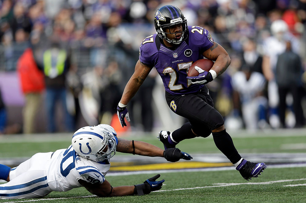 Description of . Baltimore Ravens running back Ray Rice (27) runs with the ball and gets away from Indianapolis Colts inside linebacker Jerrell Freeman (50), for a 47 yard gain, during the first half of an NFL wild card playoff football game Sunday, Jan. 6, 2013, in Baltimore. (AP Photo/Patrick Semansky)