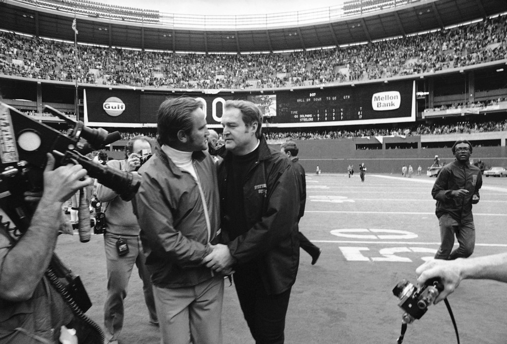 . Miami Dolphins Coach Don Shula, left, embraces Pittsburgh Steelers Coach Chuck Noll on Jan. 1, 1972 in Pittsburgh, as the scoreboard behind them tells of the Dolphins 21-17 win over the Steelers for the American Football Conference championship. (AP Photo)