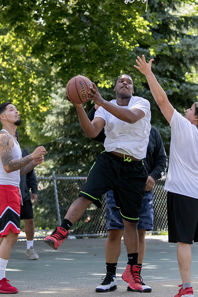 "Friends got together on Saturday to shoot some hoops at the Joanne ""Mama"" Fitz Memorial Playground's basketball court in Fitchburg. Putting up a shot is Wilson Fisk from Fitchburg. SENTINEL & ENTERPRISE/JOHN LOVE"