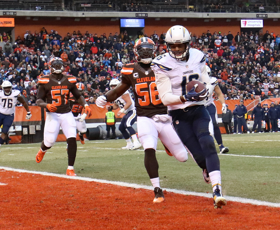 . San Diego Chargers wide receiver Tyrell Williams (16) scores a touchdown after a 1-yard pass as Cleveland Browns inside linebacker Demario Davis (56) defends in the second half of an NFL football game, Saturday, Dec. 24, 2016, in Cleveland. (AP Photo/Aaron Josefczyk)
