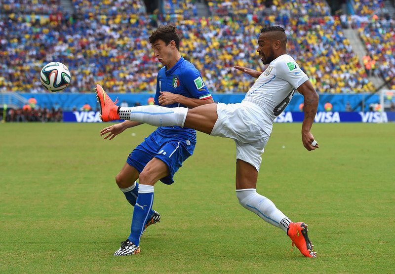 . Alvaro Pereira of Uruguay and Matteo Darmian of Italy compete for the ball during the 2014 FIFA World Cup Brazil Group D match between Italy and Uruguay at Estadio das Dunas on June 24, 2014 in Natal, Brazil.  (Photo by Matthias Hangst/Getty Images)