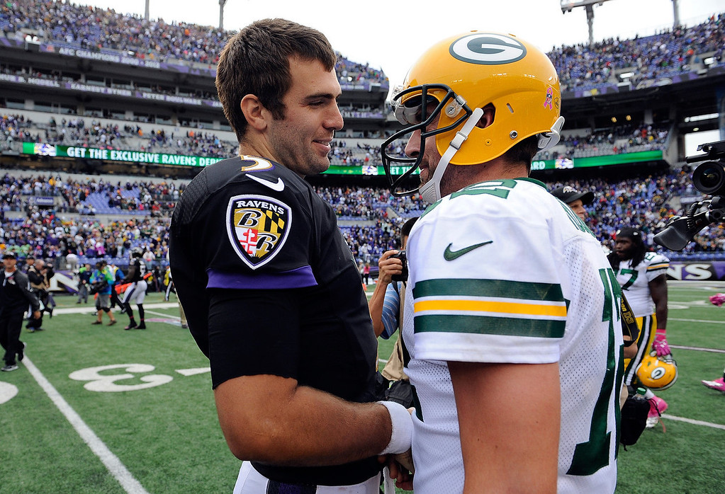 . Aaron Rodgers #12 of the Green Bay Packers and Joe Flacco #5 of the Baltimore Ravens shake hands after the Packers defeated the Ravens 19-17 during a game at M&T Bank Stadium on October 13, 2013 in Baltimore, Maryland.  (Photo by Patrick McDermott/Getty Images)