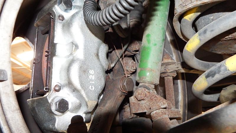 New calliper, locking wire incorrectly tightened