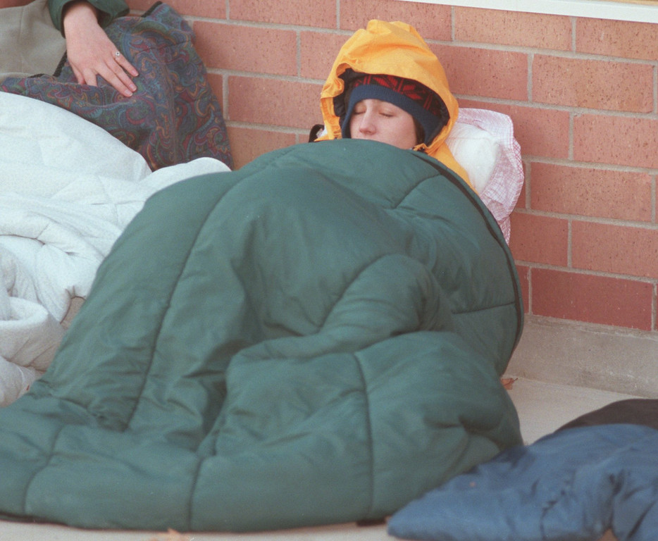 . Freshman Michelle Vantrump, 19, trying to stay warm early Tuesday morning. Students line up overnight for basketball tickets at Oakland University\'s new sports arena. Oakland University is becoming a division 1 school, and the highly rank MSU Spartans will be their first home opponent. Vantrump had been in line since 11 p.m. the previous night.
