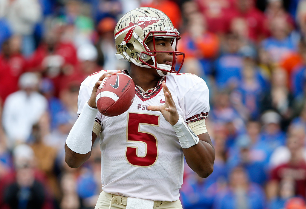 . Jameis Winston #5 of the Florida State Seminoles attempts a pass during the game against the Florida Gators on November 30, 2013 in Gainesville, Florida.  (Photo by Sam Greenwood/Getty Images)