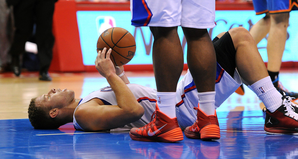 . The Clippers\' Blake Griffin lies on the court after being called for a foul on the Thunder\'s Russell Westbrook, Thursday, May 15, 2014, at Staples Center. (Photo by Michael Owen Baker/Los Angeles Daily News)