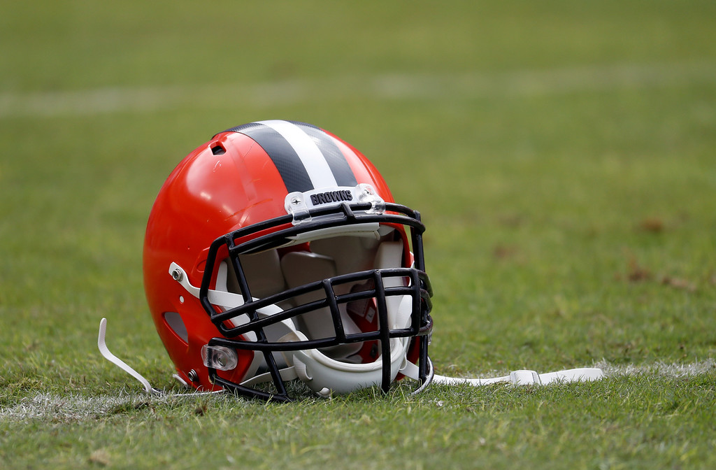 . A Cleveland Browns helmet is seen on the field before an NFL football game against the Washington Redskins Sunday, Oct. 2, 2016, in Landover, Md. (AP Photo/Carolyn Kaster)