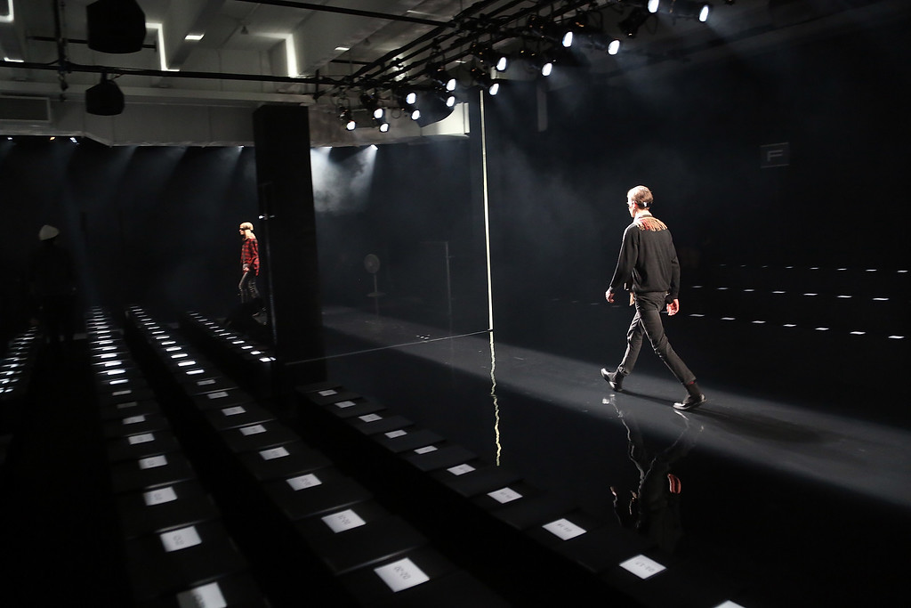 . NEW YORK, NY - FEBRUARY 15:  Models prepare before the Porsche Design fashion show during Mercedes-Benz Fashion Week Fall 2015 at Center 548 on February 15, 2015 in New York City.  (Photo by Monica Schipper/Getty Images)