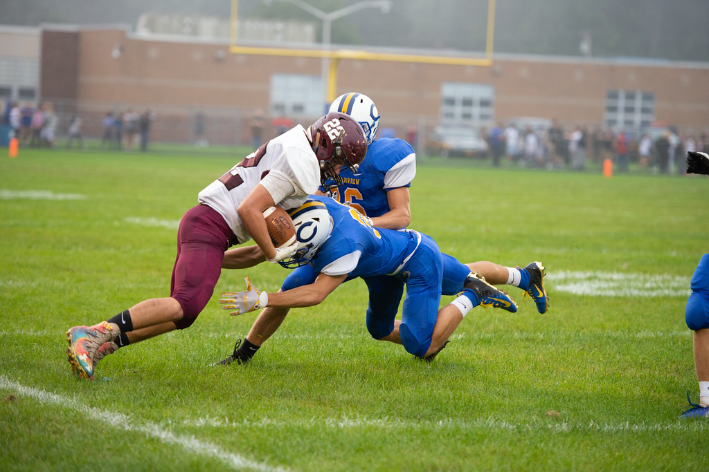 . Aimee Bielozer - The Morning Journal<br> Wellington\'s Kaleb Taylor works around the Clearview defense on Sept. 14.