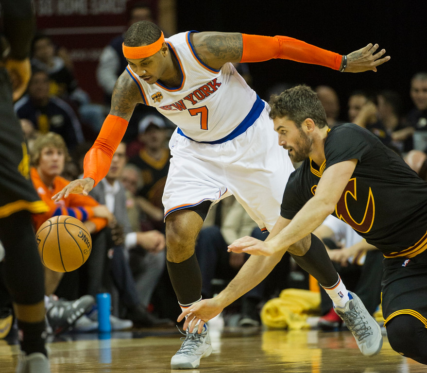 . New York Knicks\' Carmelo Anthony (7) beats Cleveland Cavaliers\' Kevin Love (0) to the ball during the second half of a basketball game in Cleveland, Tuesday, Oct. 25, 2016. Cleveland won 117-88. (AP Photo/Phil Long)