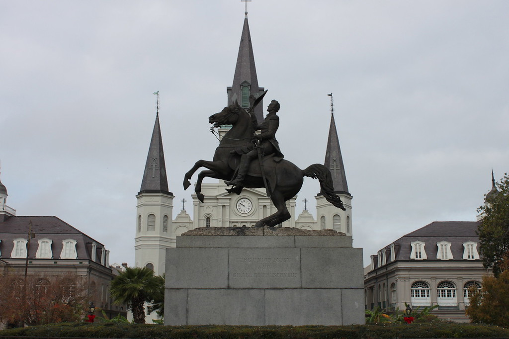 A figure on horseback against a church steeple at Jackson Square in New Orleans