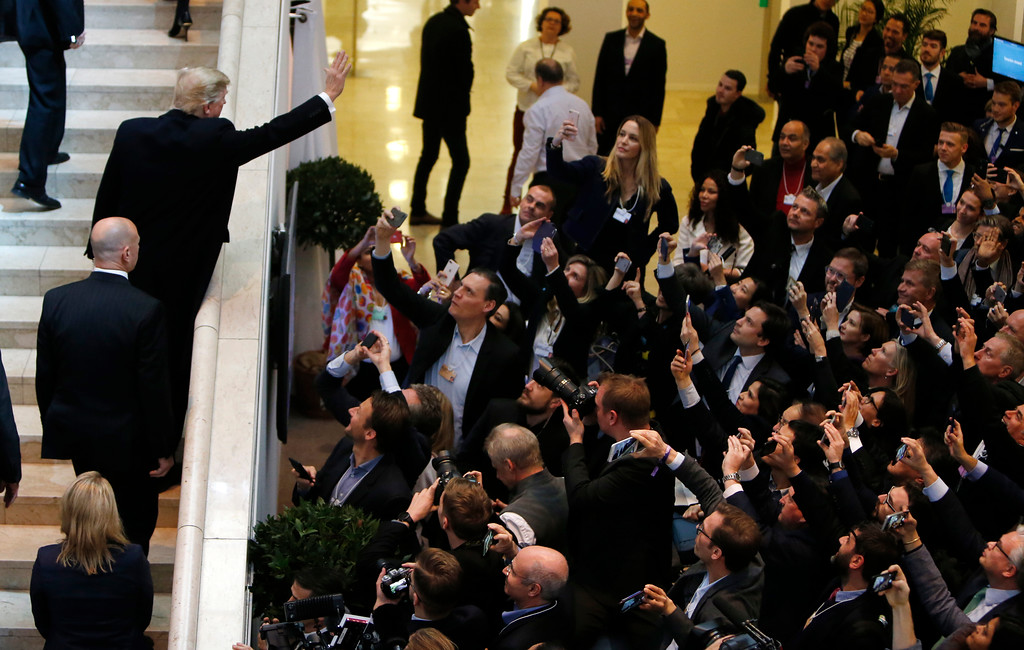 . U.S. President Donald Trump waves as he arrives during the annual meeting of the World Economic Forum in Davos, Switzerland, Thursday, Jan. 25, 2018. (AP Photo/Michael Probst)